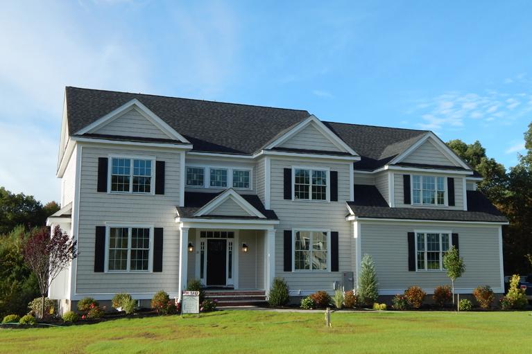 tan-white-trim-blk-shutters